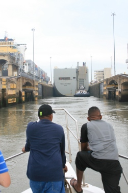 Entering the locks behind a large cargo ship