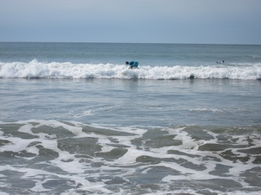 adults surfing in Venao